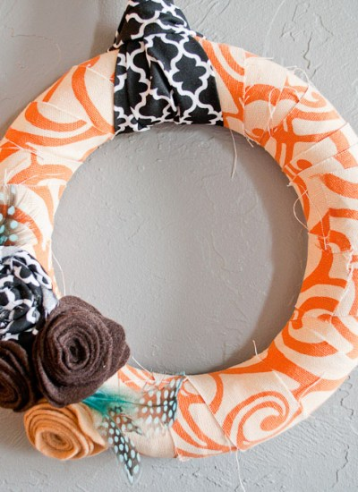 This fall wreath using fabric and flower embellishments is adorable and so easy to make. With these simple instructions, you'll be making these wreaths for all your friends and family!
