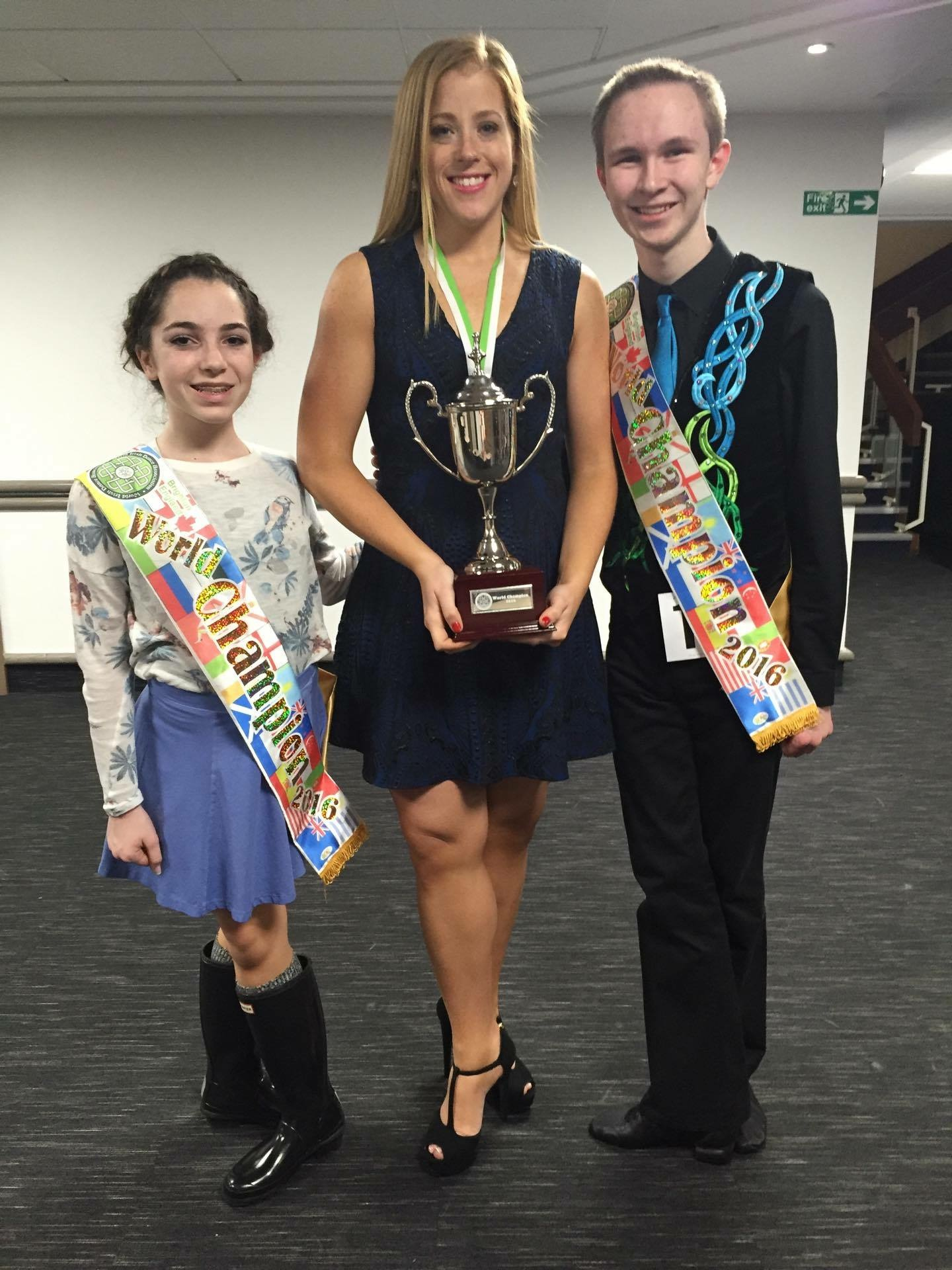 Angela Brunetti and Matthew Jones pose with their teacher, Kate O'Brien, after both winning the 2016 WIDA World Championships