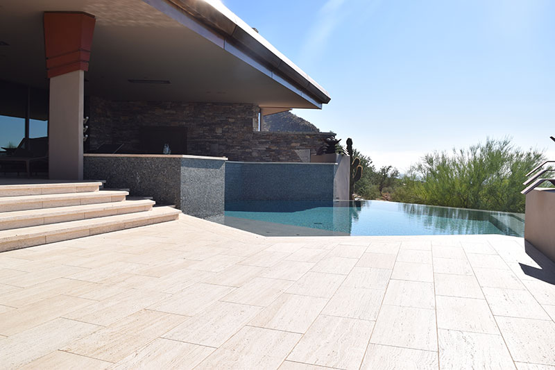 sparkling clean swimming pool and deck