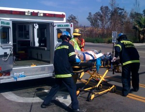 EAS EMTs and Brea Fire Dept personnel moving patient to Mercy Air helicopter