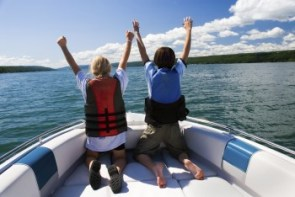 Kids enjoying a ride on their boat with boat insurance