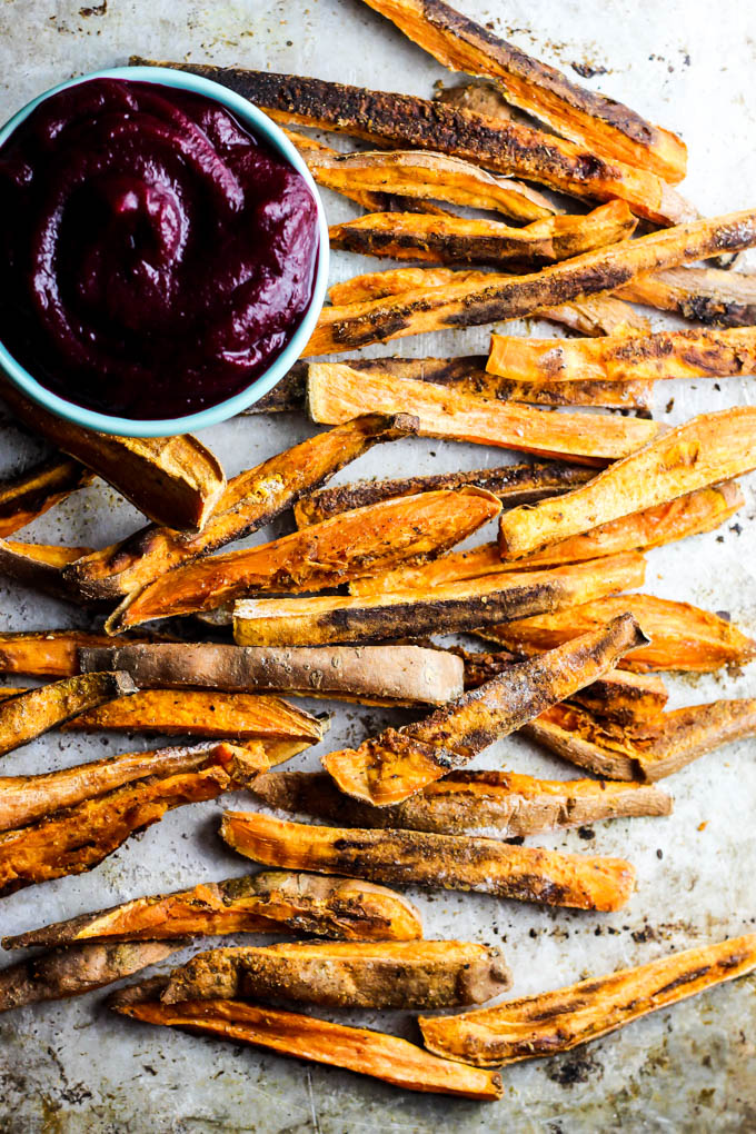 These extra Crispy Sweet Potato Fries dipped in tangy beet ketchup are the perfect addition to any dinner plate! A delicious vegan & gluten-free side dish.