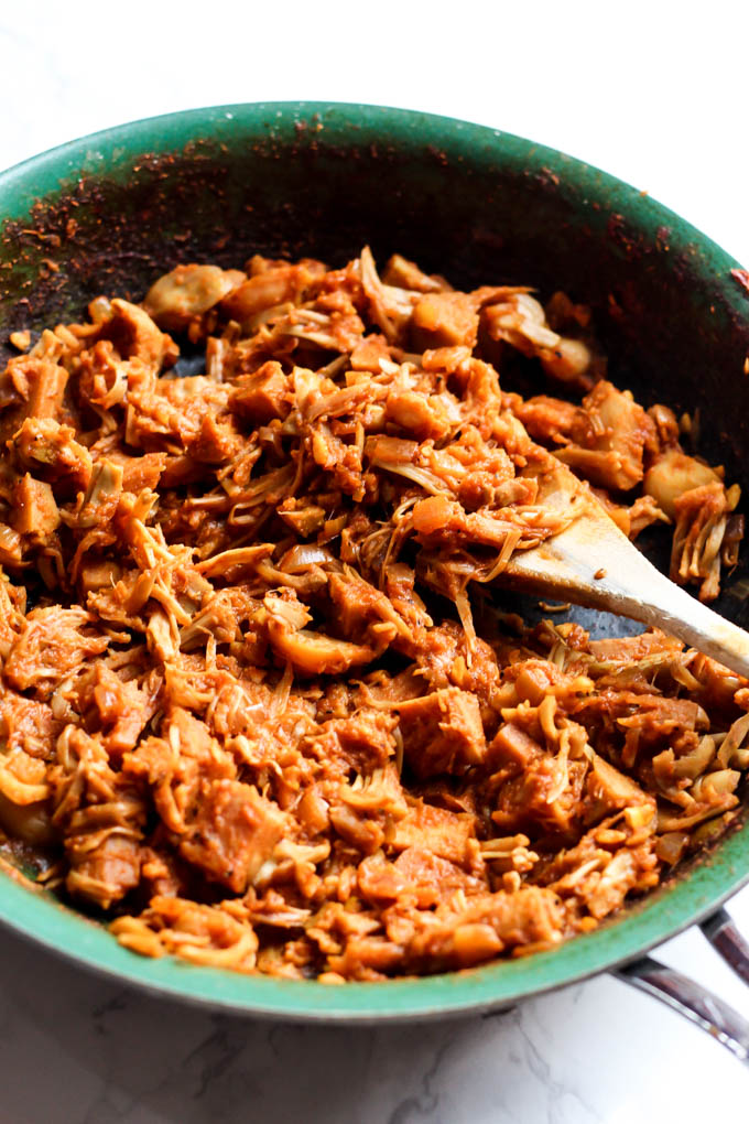 Meet jackfruit: the BEST vegan pulled pork alternative! These Easy Vegan BBQ Jackfruit Sandwiches are your new summer staple for cook-outs & parties.
