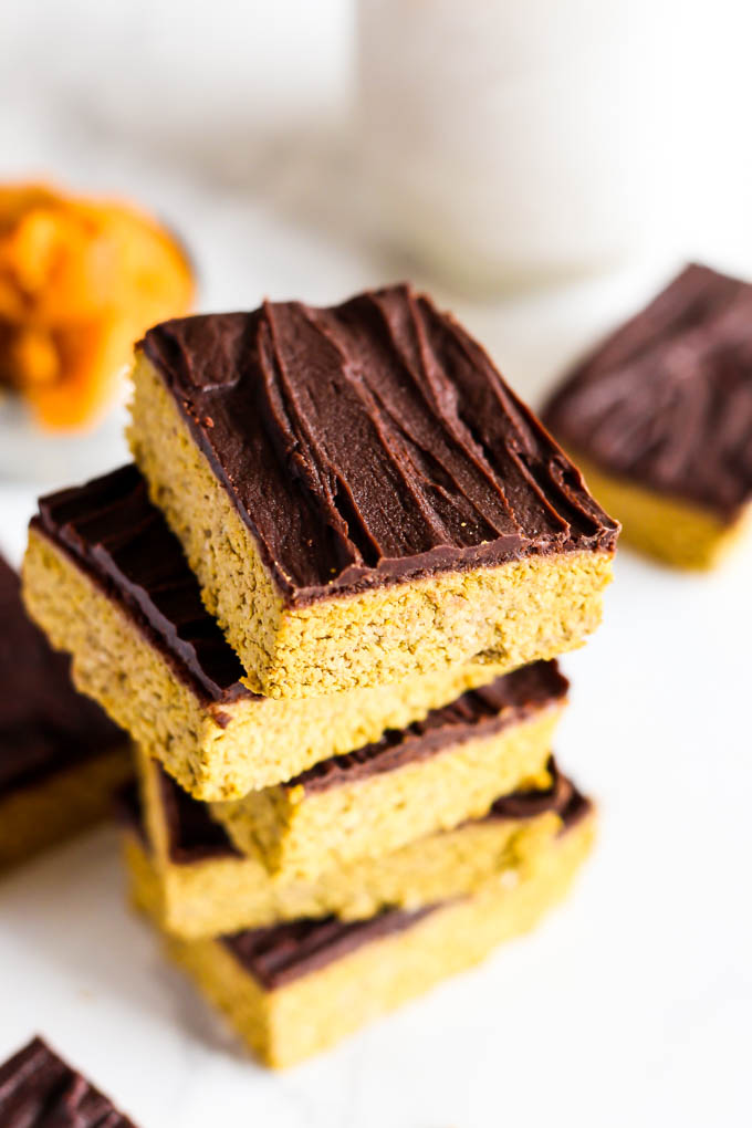Celebrate fall with these Chocolate Pumpkin Protein Bars - perfect for a sweet snack or healthy dessert! They're vegan, gluten-free & done in under 1 hour.