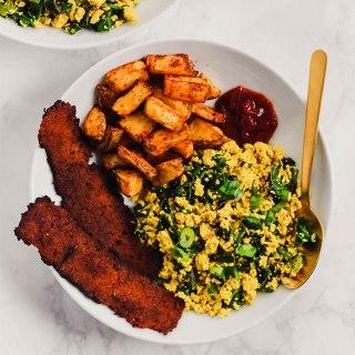 Vegan Breakfast Plate: Bacon, Tofu Scramble, and Potatoes