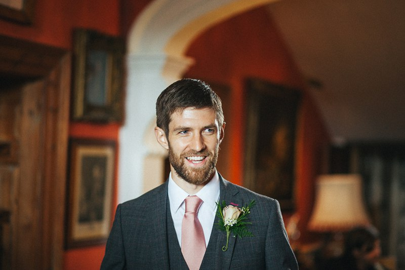 Smiling groom at the ceremony Ashbourne