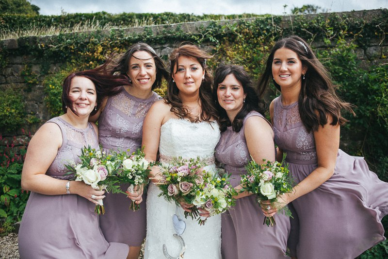 Bride with her Bridesmaids in blush purple dresses