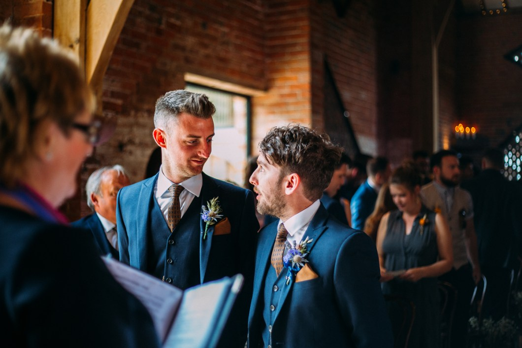 Best man and groom waiting