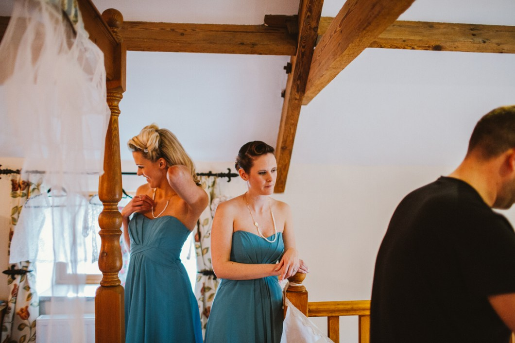 Bridesmaids wearing blue strapless dresses