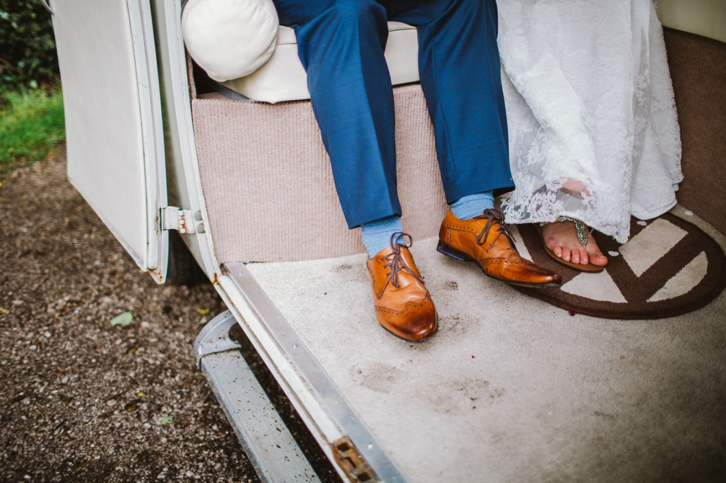 Boho bride and groom in VW camper