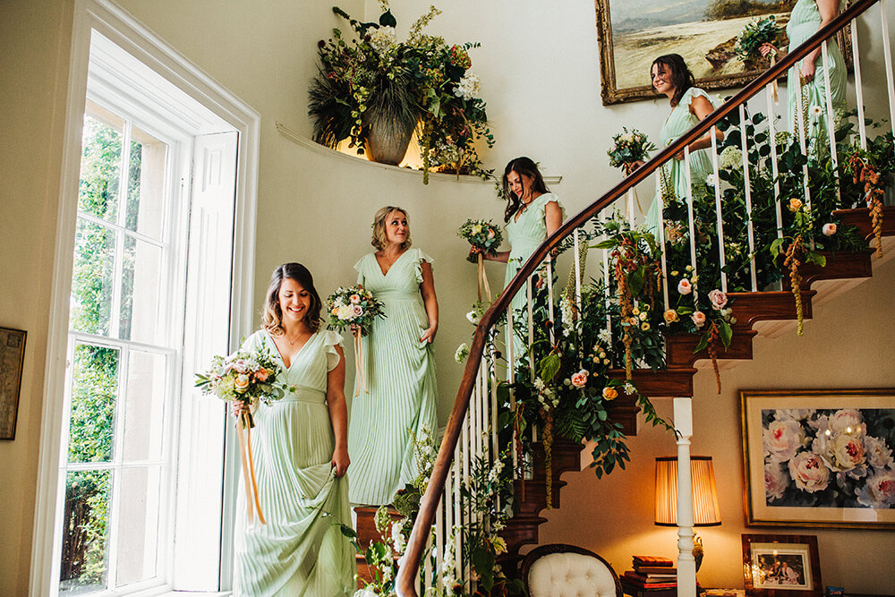Bridesmaids walking downstairs at Eastbridgford Hill