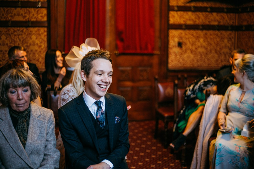 The best man laughing at the start of the ceremony