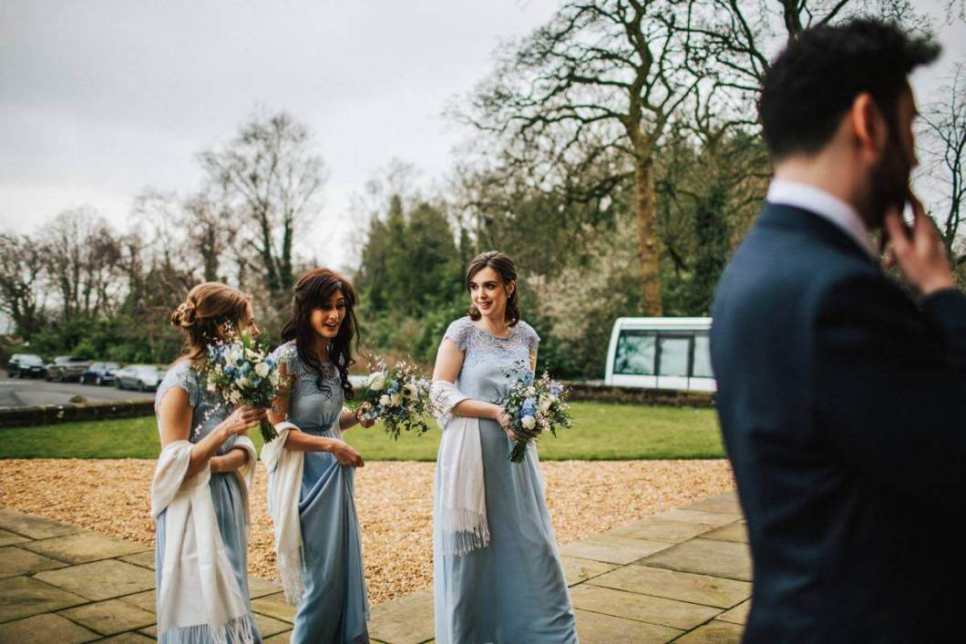 Bridesmaids wearing blue dresses