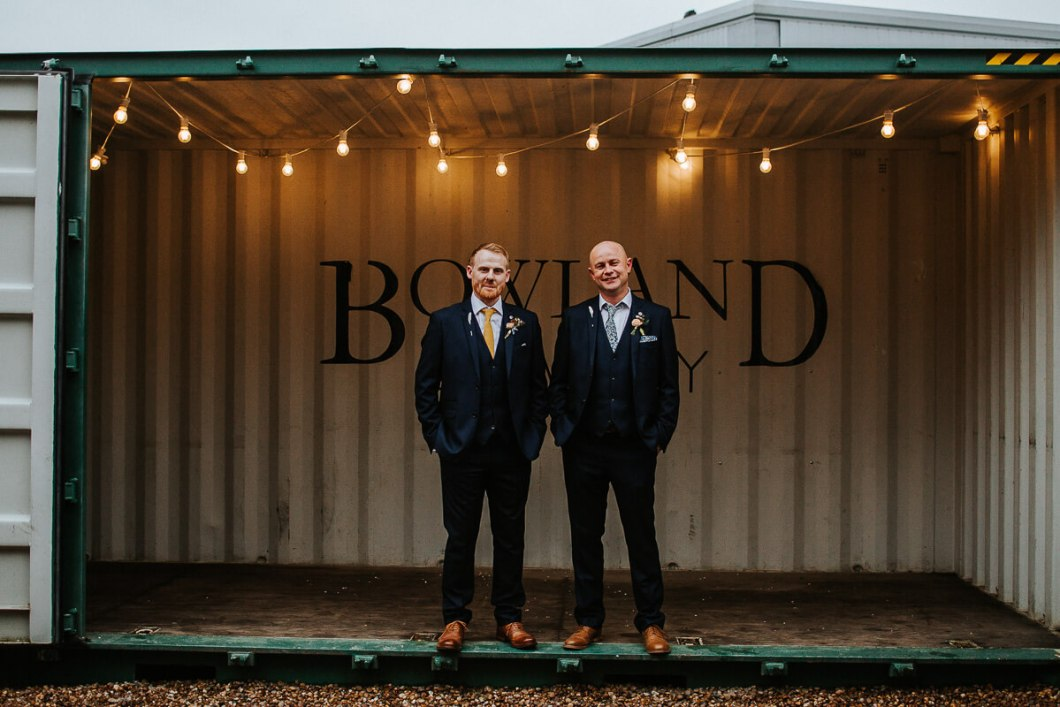 Groom and best man wearing navy suits
