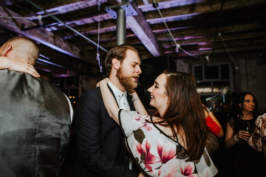 Natural photo of guests dancing