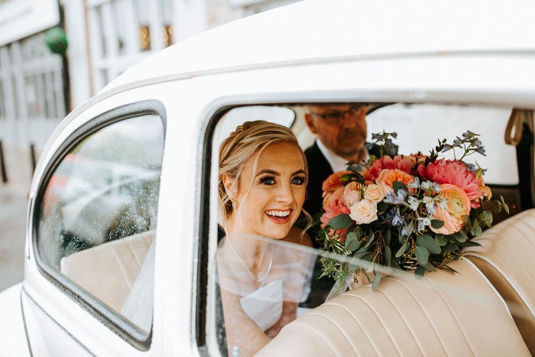 The bride arriving in a WV camper van