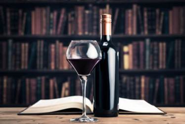 Book library, wine bottle and wine glass