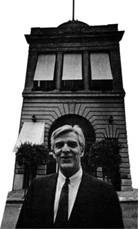 Howard Gossage in front of repurposed firehouse where he housed his ad agency