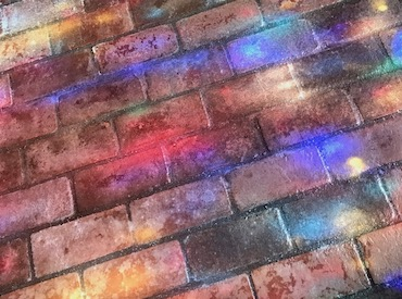 Colored light on brick