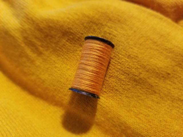 living with less means valuing your clothes and making them last longer with simple sewing repairs