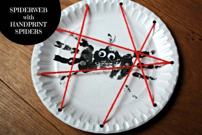 spiderweb with handprint spiders
