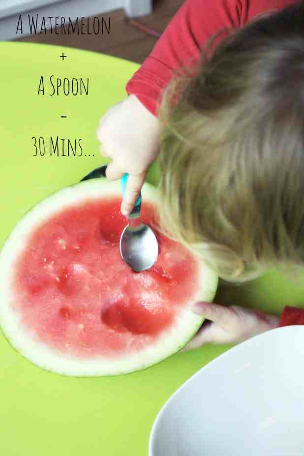 Great kids activity, a watermelon and a spoon