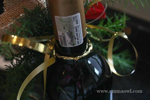 Poinsettia on a bottle of wine