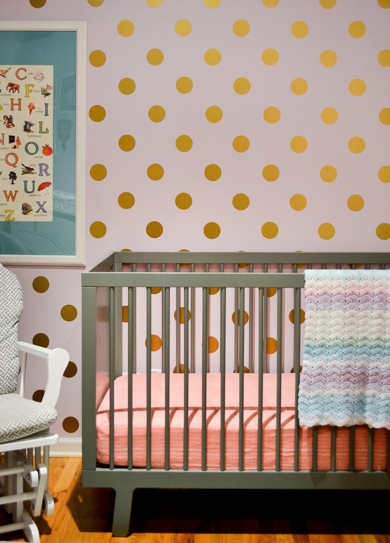 Polka dot wall in loft nursery design