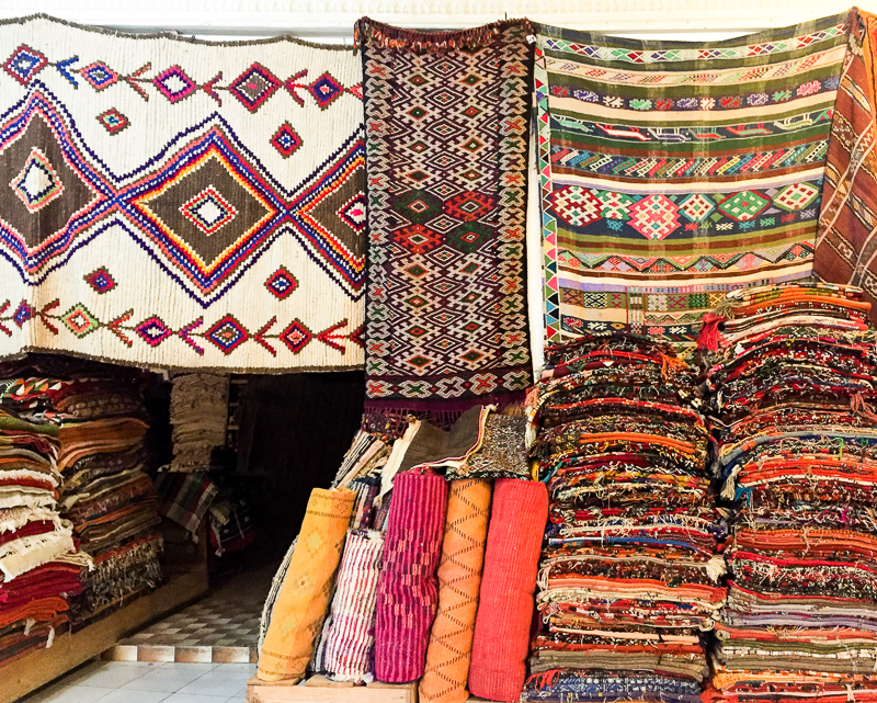 Moroccan rugs in Marrakech souk stall