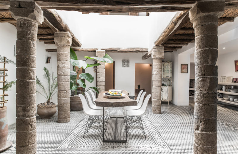 Dining area with live edge table at Five Columns Essaouira