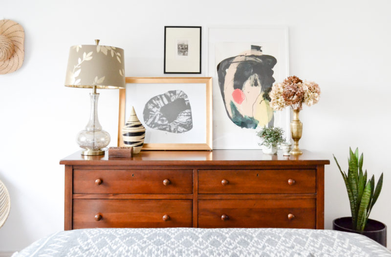 Global Neutral Master Bedroom Reveal - Dresser with leaning artwork