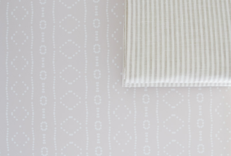Behe_mudcloth removable wallpaper by Holli Zollinger on Spoonflower behind linen stripe roman blinds from Blinds 2Go