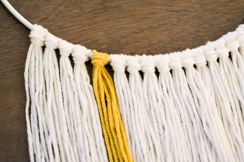 Close up of larks head knots - How to Make a Wall Hanging with Wooden Beads DIY Tutorial