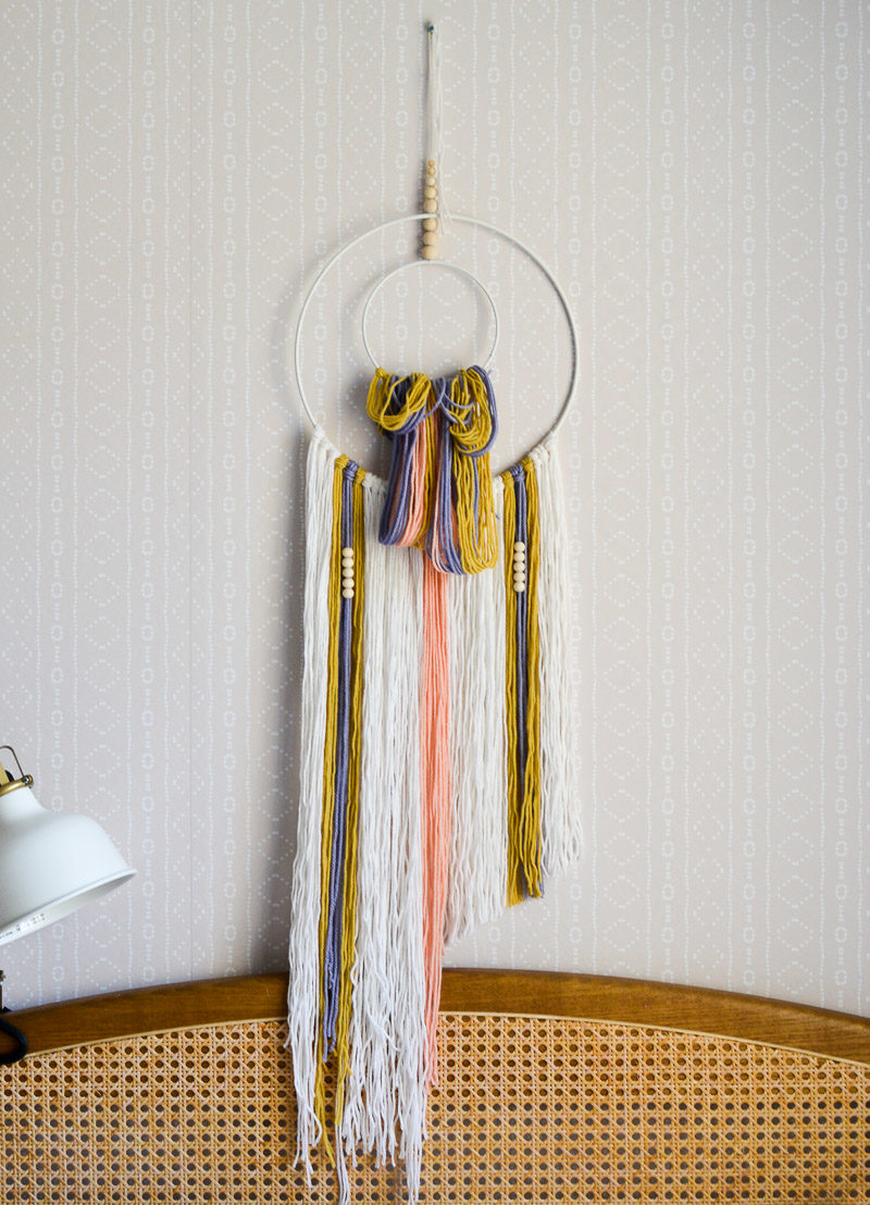 Trimming yarn on DIY wall hanging