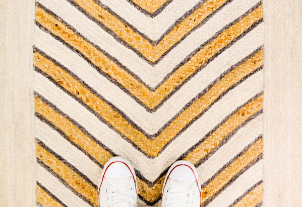 Grubby Converse on a pretty rug