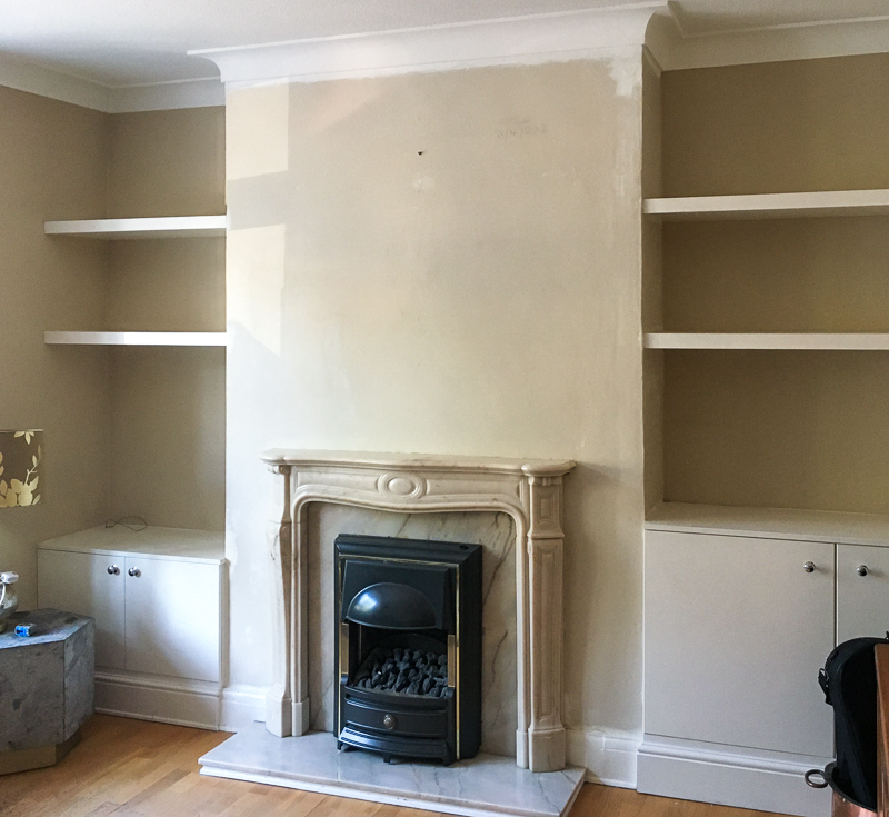Wallpaper stripped from fireplace wall