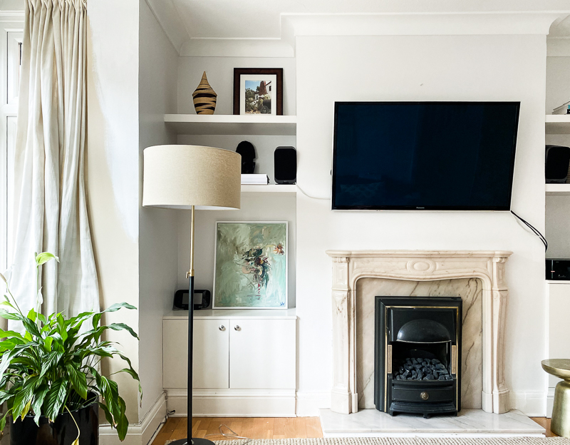 Giant Sodding TV Above Fireplace