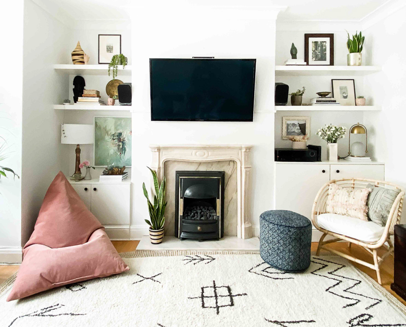 Eclectic living room makeover in Edwardian house with TV hung above fireplace