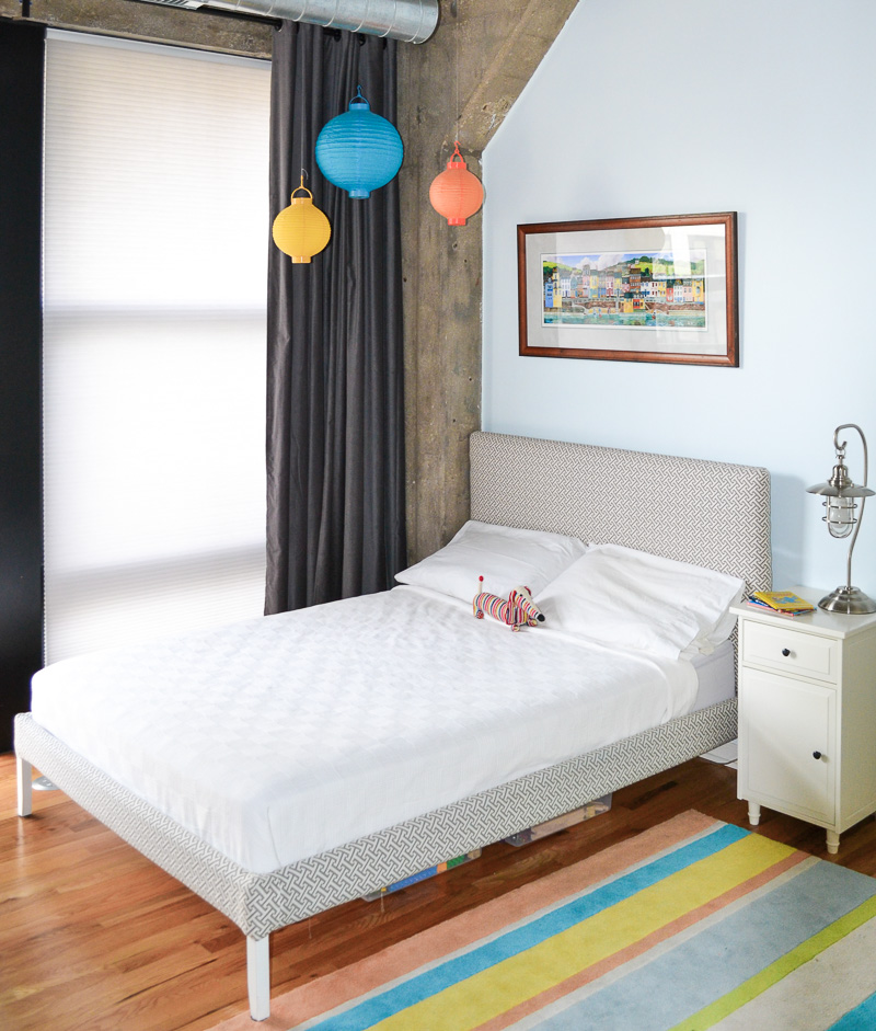DIY Bed in loft bedroom with concrete  accents