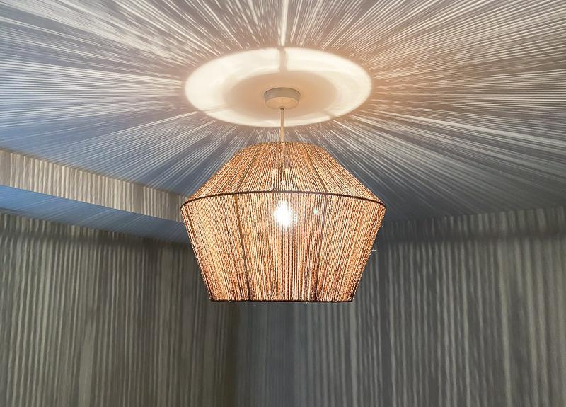 Rattan pendant light in boho master bedroom