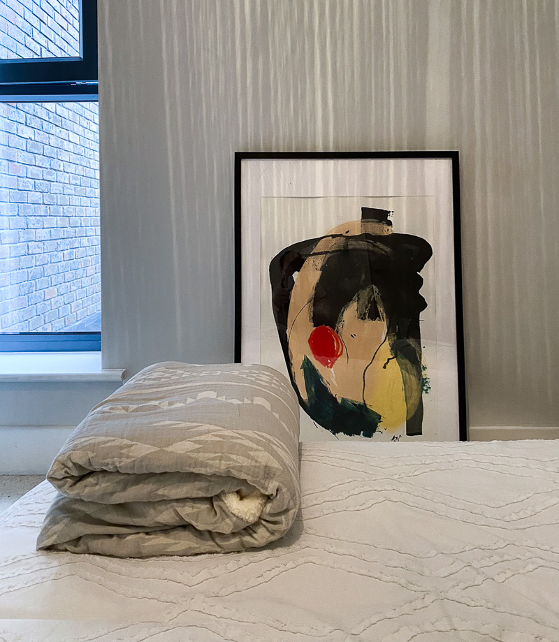 Abstract painting and textured bedding