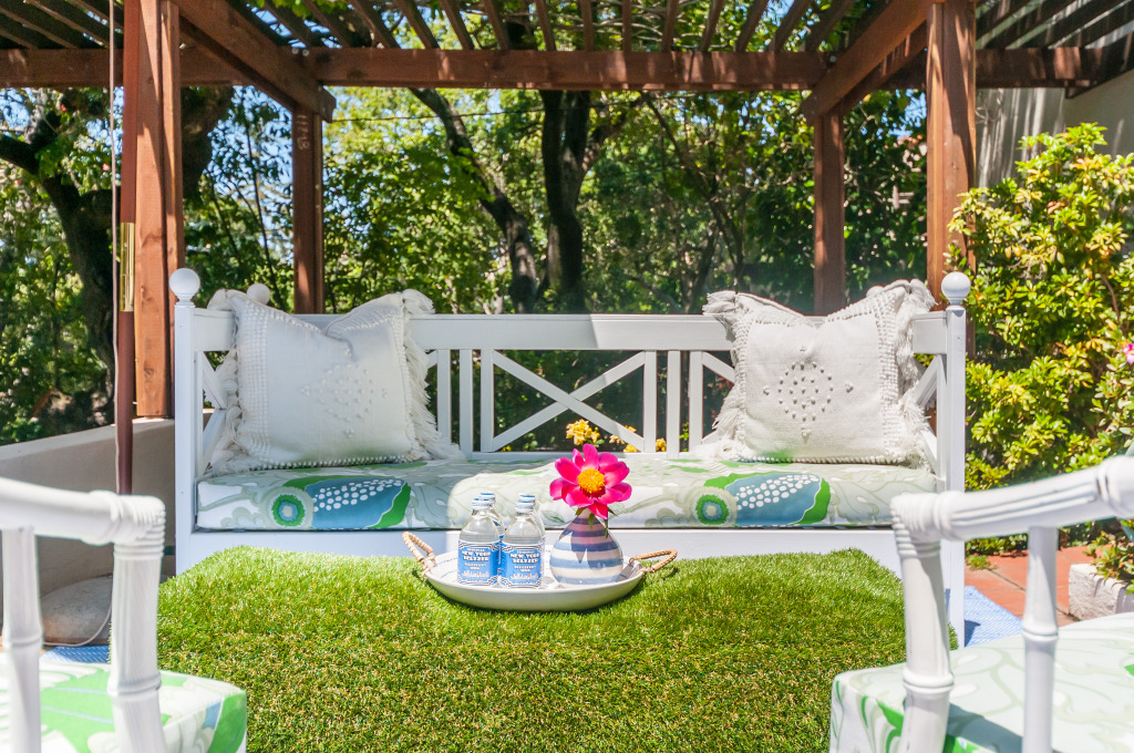 Astroturf pouf in patio reveal