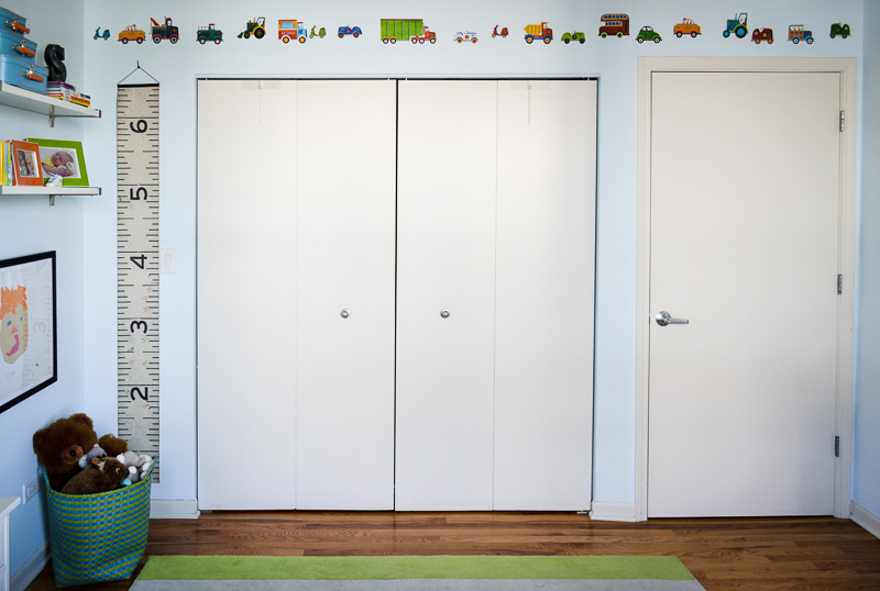 Truck themed decor over closet closet in toddler bedroom