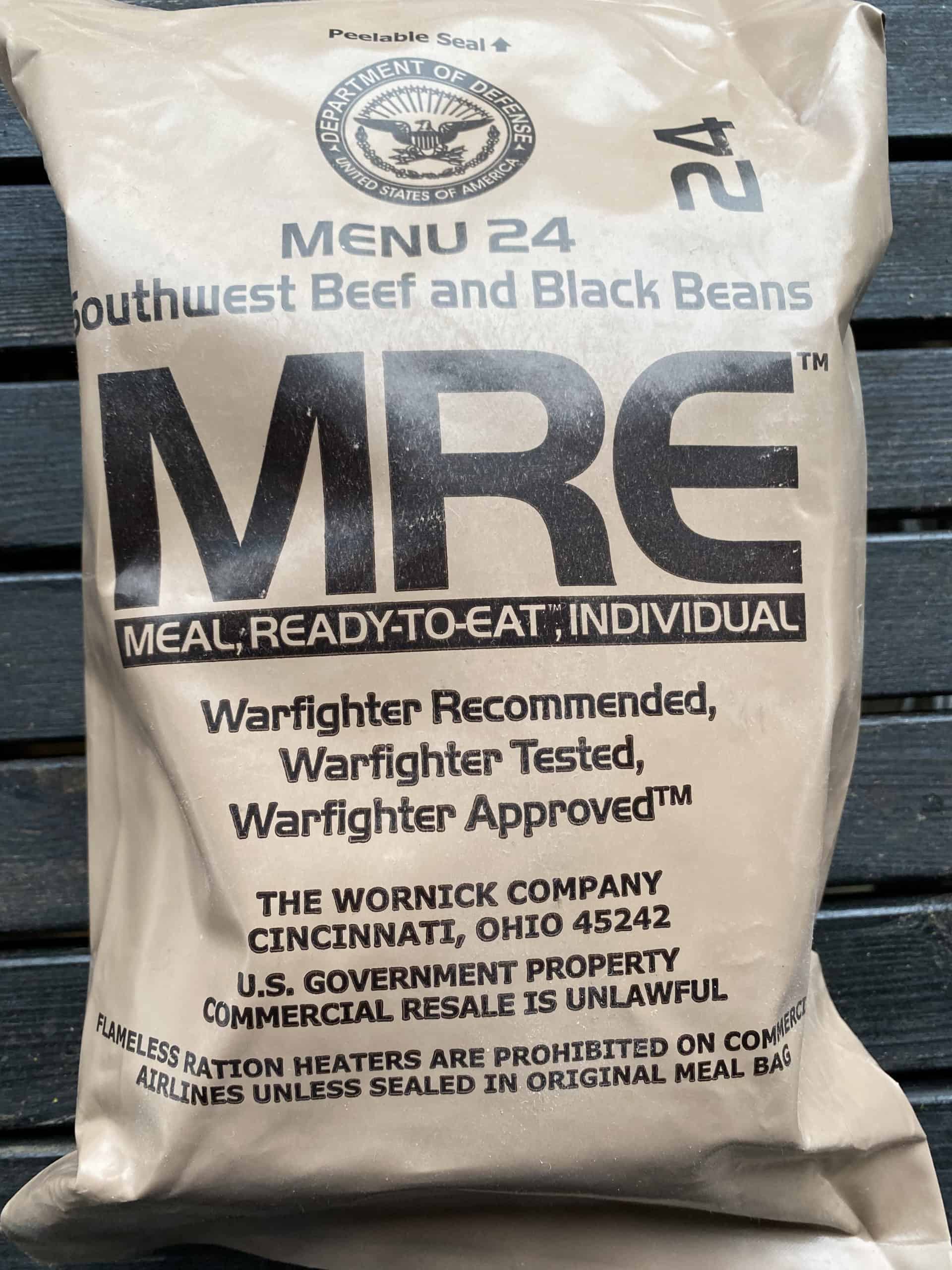 Tan plastic bag with letters MRE, meal-ready-to-eat