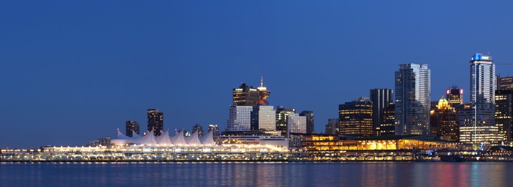 City lights at night over the water in Vancouver, BC.