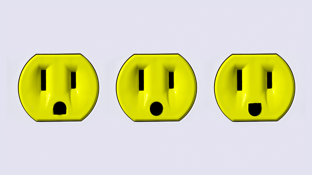 Three bright yellow electrical plugins.