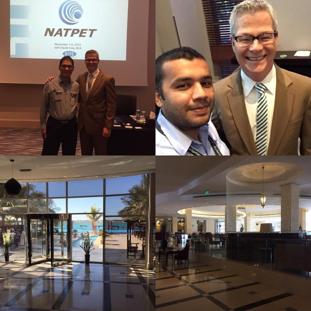 """Four photos: The top left shows two men standing shoulder to shoulder with their arms around each other indoors infront of a projected slide saying """"NATPET"""". Top right is a photo of two men smiling and standing shoulder to shoulder. We see them from the shoulders up. Both have ties. The bottom two are from the inside of a hotel. The left looks down a hall, out a wall of floor to ceiling windows and out onto a beach."""