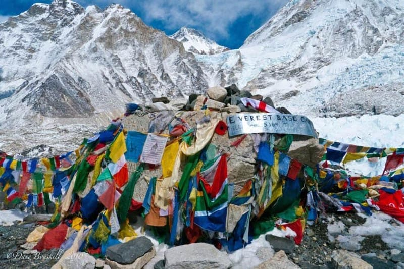 everest-base-camp-trek-rock-covered-in-flags