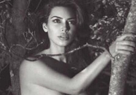 Kim Kardashian Poses In Nothing But Boots