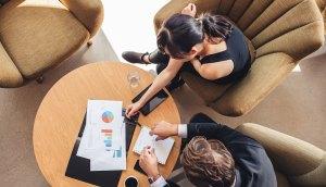 Business Investors Looking at Graphs